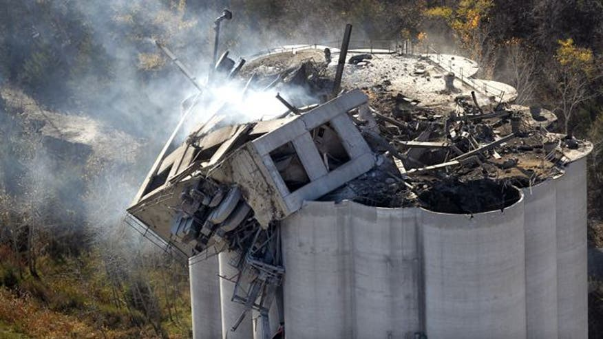 At least three killed, three missing after huge blast at grain factory