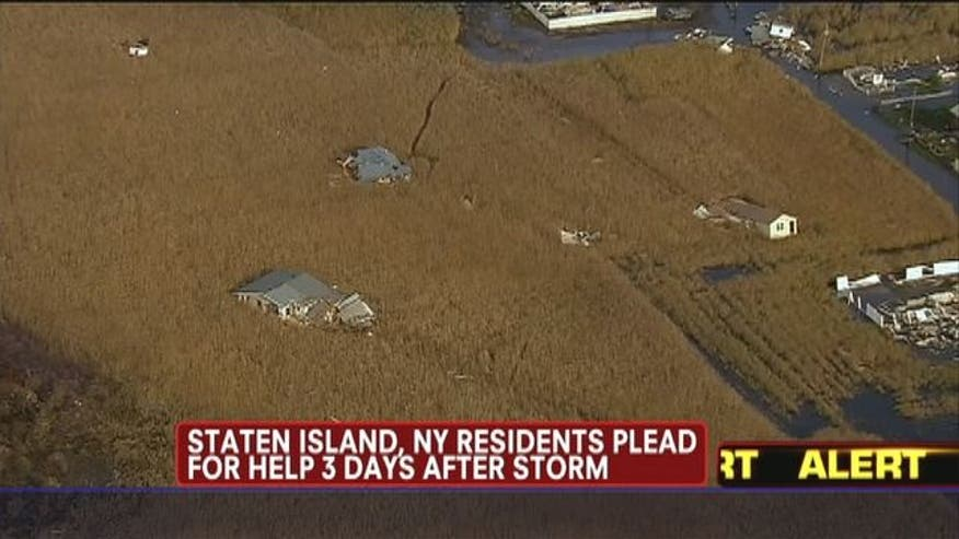 Staten Island and New York residents plead for help three days after superstorm Sandy.