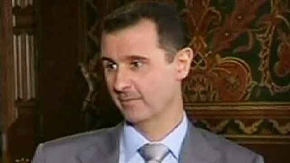 President Assad vows to 'live and die' in Syria
