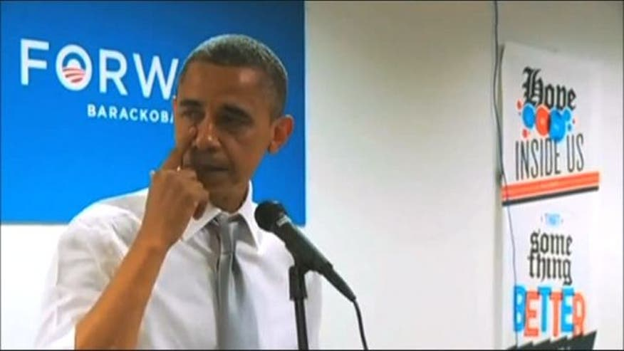 President Barack Obama wipes away tears while speaking to staff after election victory.