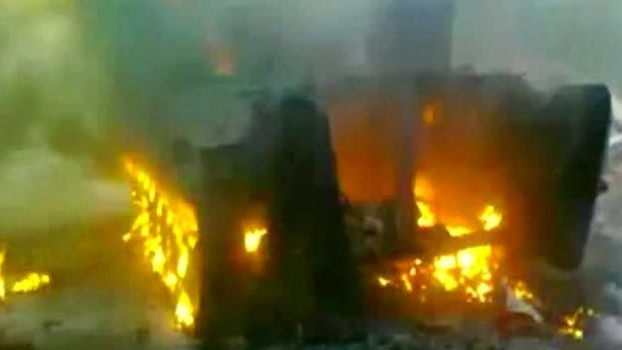 Amateur video reportedly shows shelling of Homs, burning wreckage of government tank