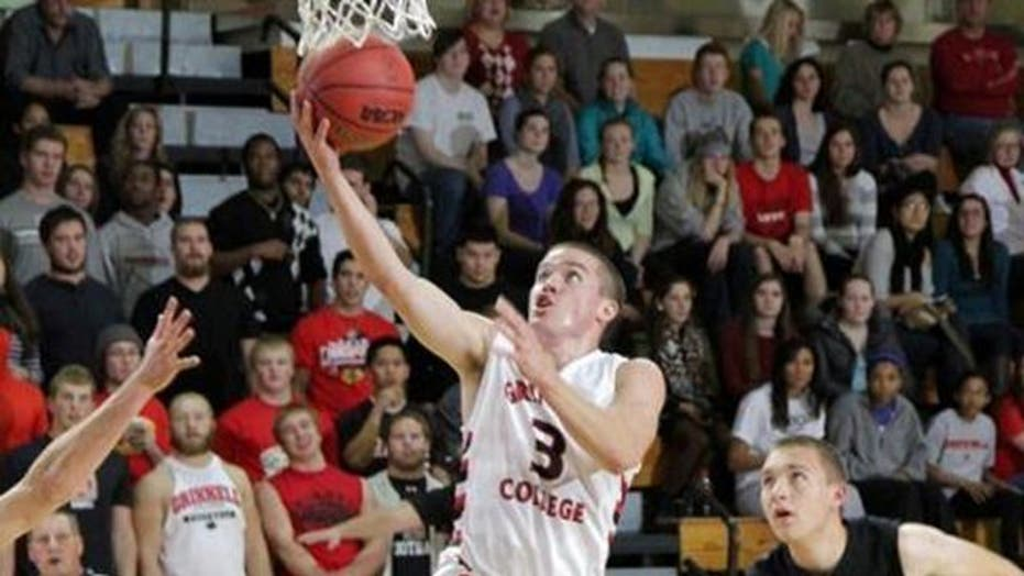 He's on fire! Hoopster shatters NCAA scoring record