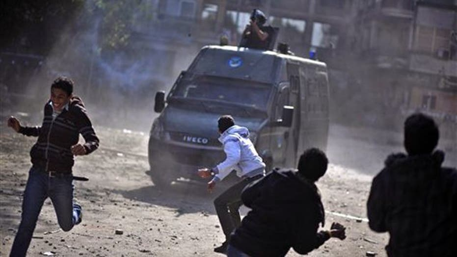 Protests rage in Egypt over Morsi power grab