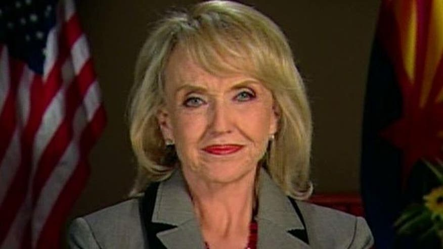 Ariz. Gov. Jan Brewer applauds High Court's decision to hear challenge, but who has the advantage?