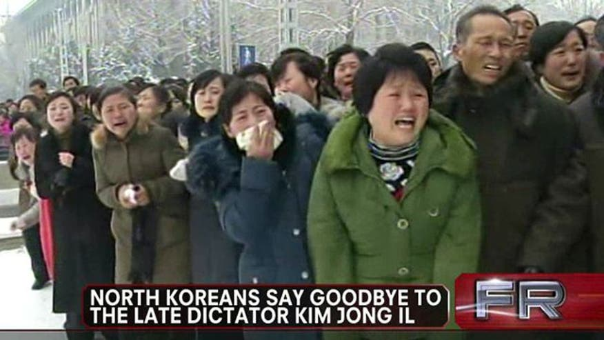 Thousands line Kim Jong-Il's funeral procession route